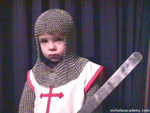 Alex in maille armor with sword and tabard
