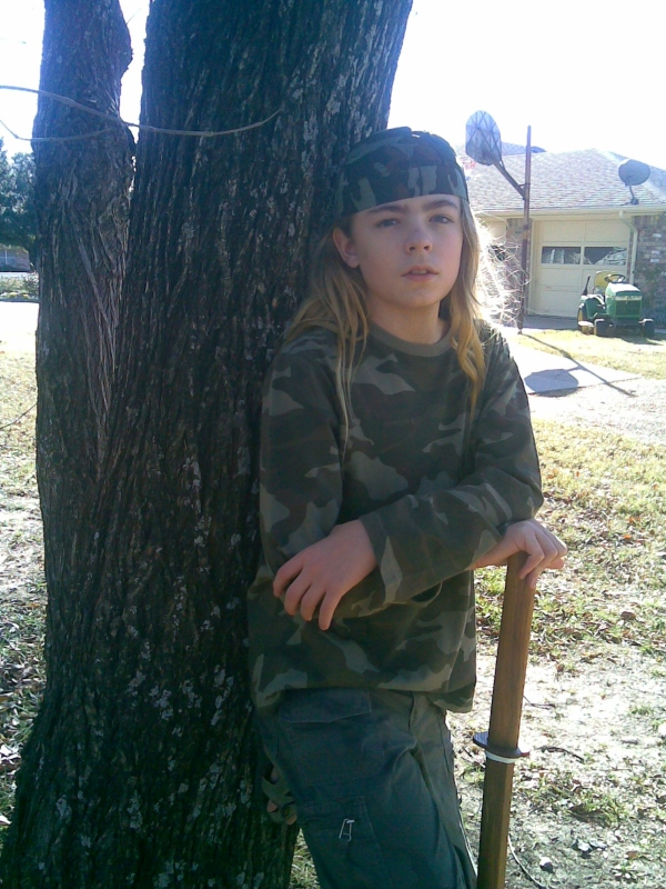 Alex in camouflage with wooden practice sword